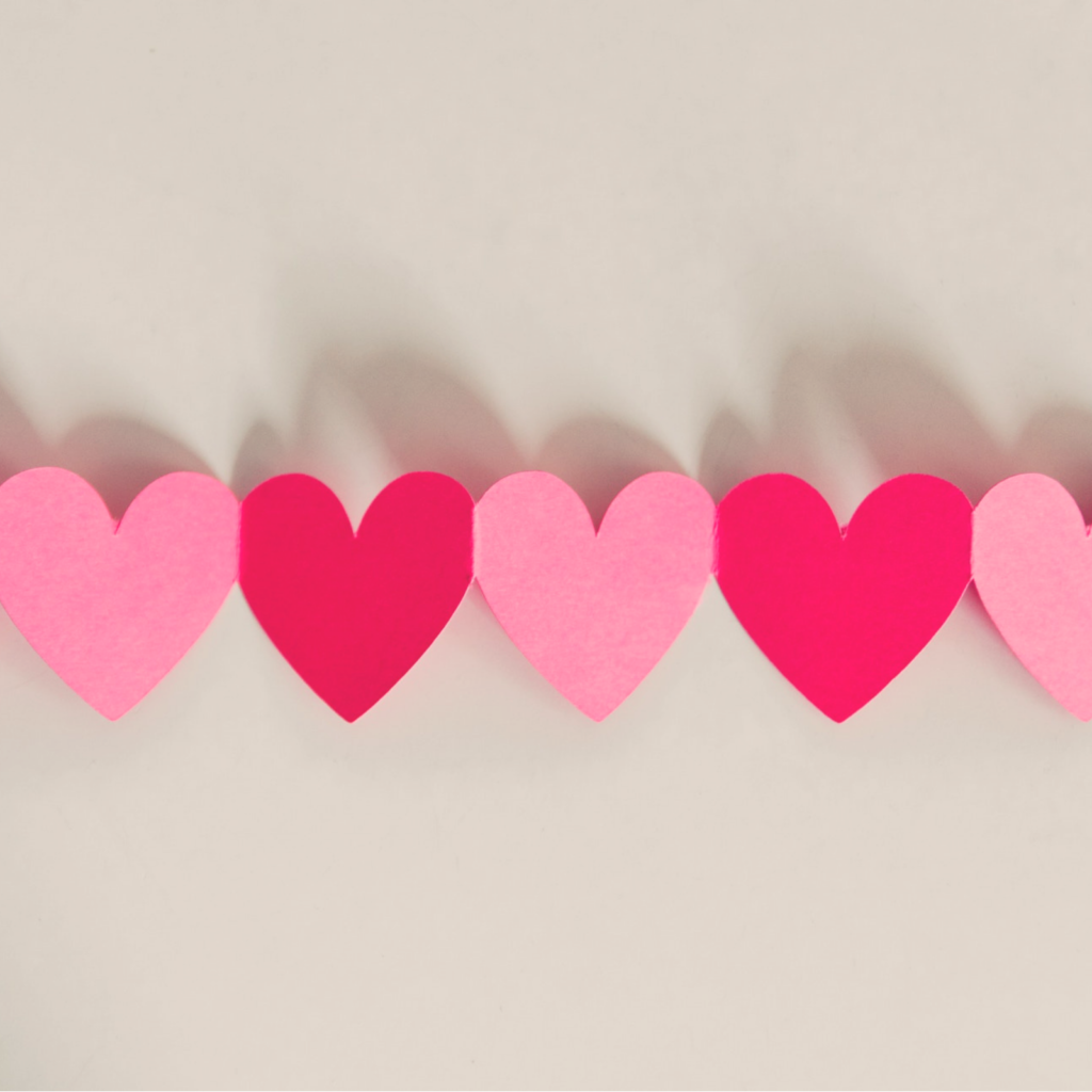 cut out hearts next to each other for a single on valentines day post