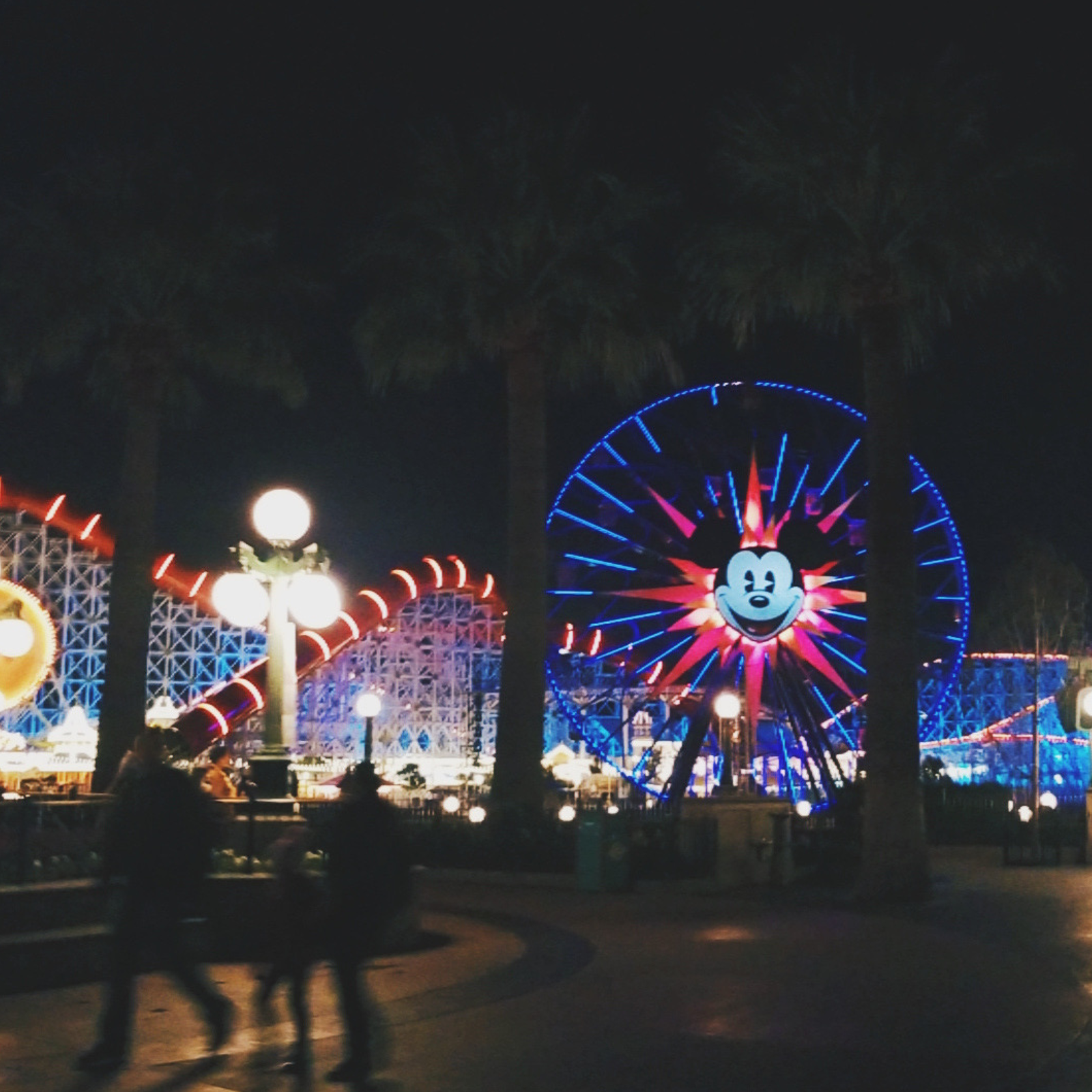 California Adventure at night with the ferris wheel with Mickey Mouse on it, lit up