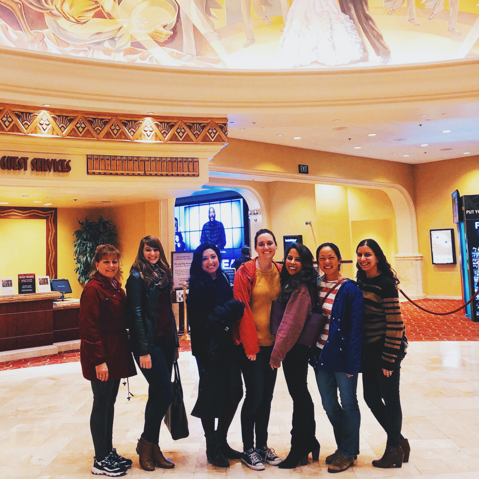 Group of girls in the lobby of a movie theater