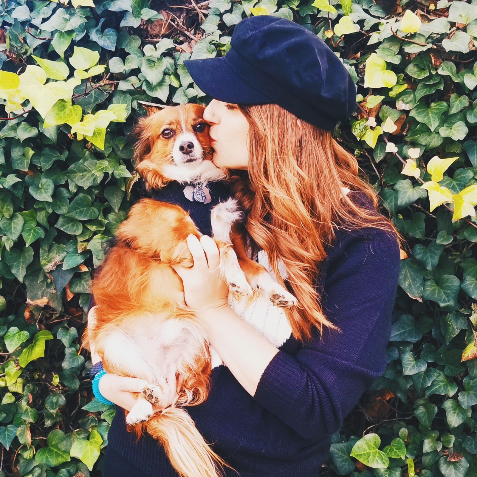 A girl kissing her dog
