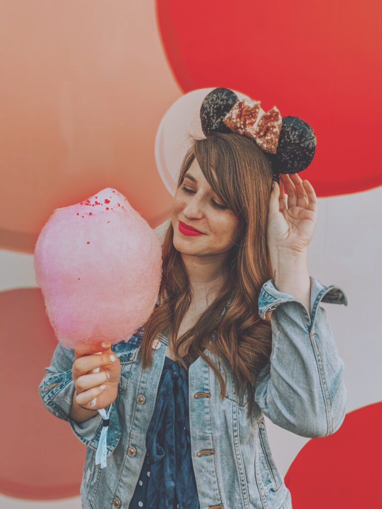A girl with pink cotton candy